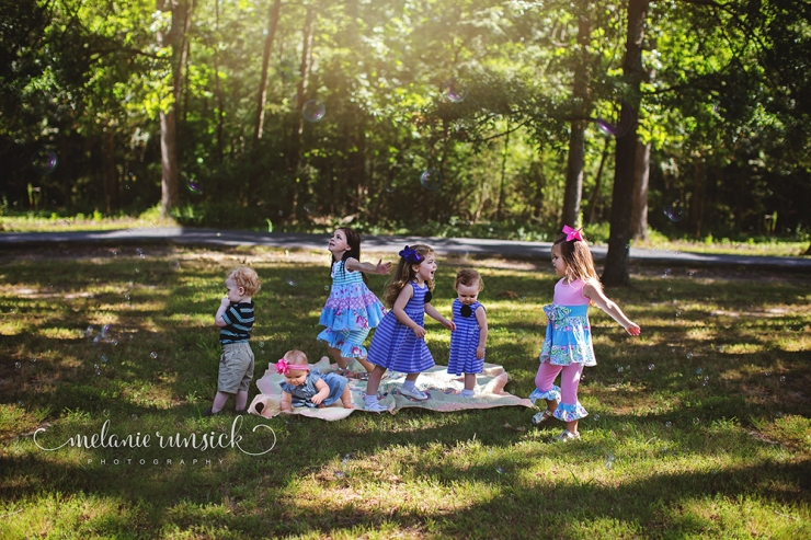 On Location photography blowing bubbles Jonesboro Arkansas Photographer